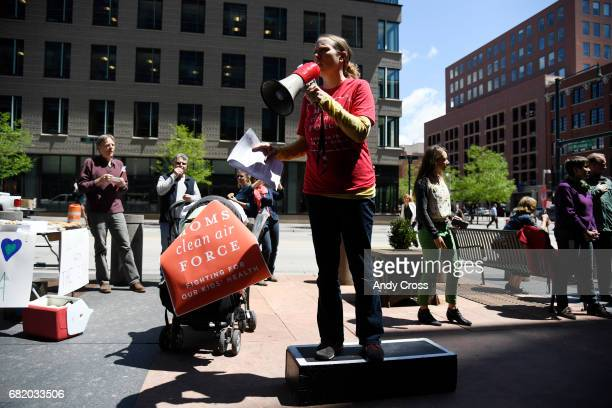 Christine Berg Moms Clean Air Force gets on a megaphone during the Coloradans Stand with US Environmental Protection Agency rally outside of the EPA...