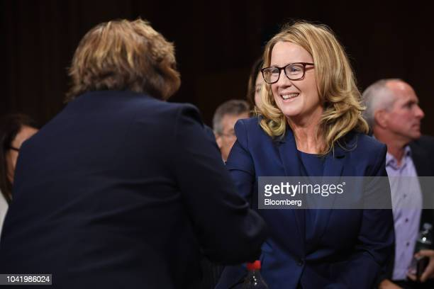 Christine Blasey Ford center shakes hands with Rachel Mitchell a Republican prosecutor from Arizona right during a Senate Judiciary Committee hearing...