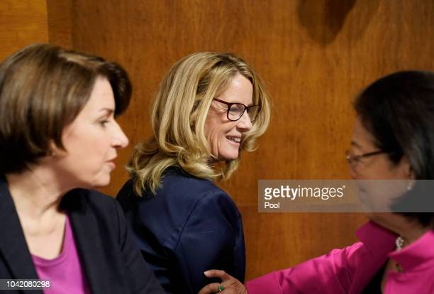 Christine Blasey Ford is greeted by Sen Mazie Hirono DHawaii and Sen Amy Klobuchar DMinn left during a break in her testimony before the Senate...