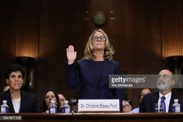 Christine Blasey Ford is sworn in before testifying the Senate Judiciary Committee in the Dirksen Senate Office Building on Capitol Hill September 27...