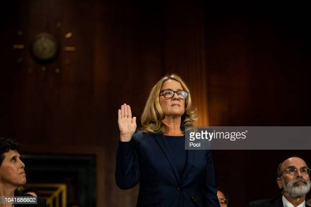 Christine Blasey Ford is sworn in prior to giving testimony before the US Senate Judiciary Committee at the Dirksen Senate Office Building on Capitol...