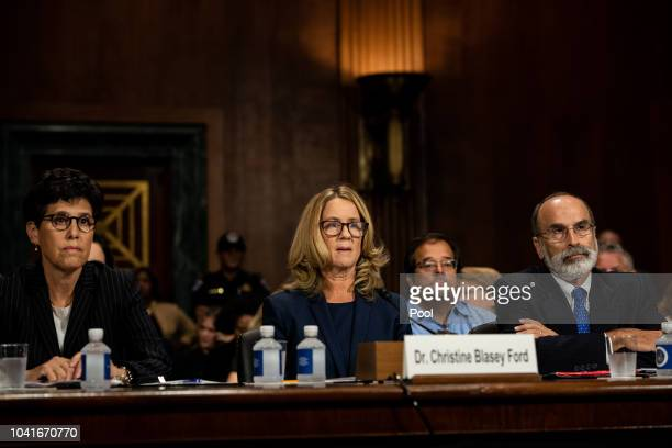 Christine Blasey Ford listens to opening statements prior to testifying before the Senate Judiciary Committee at the Dirksen Senate Office Building...