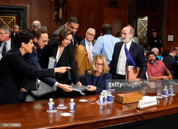 Christine Blasey Ford takes a break from testifying at a US Senate Judiciary Committee hearing at the Dirksen Senate Office Building on Capitol Hill...