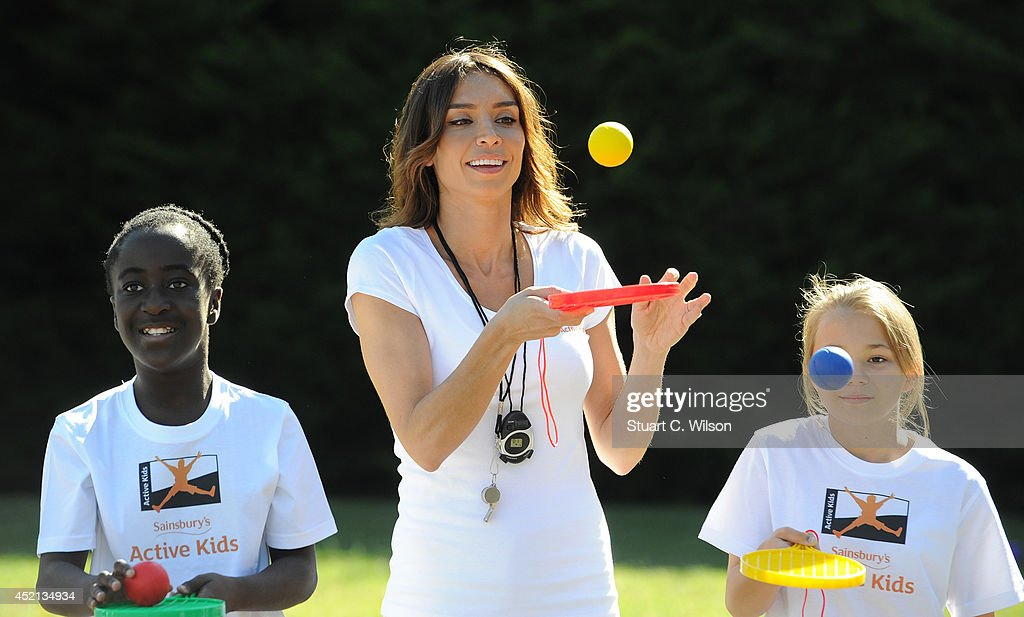 Christine Bleakley turned PE teacher today, putting children from All Saints School in Wimbledon through their paces at All Saints Church of England Primary School, Wimbledon on July 14, 2014 in London, England. They'll be racing on The Mall alongside top athletes including David Weir as part of Sainsbury's Anniversary Games. As part of the event 50 lucky children through Active Kids will be competing in a unique 'fun run' along the iconic stretch. Christine is calling on the general public to come down to The Mall on Sunday 20th July to watch sporting heroes race and cheer on the children taking part.