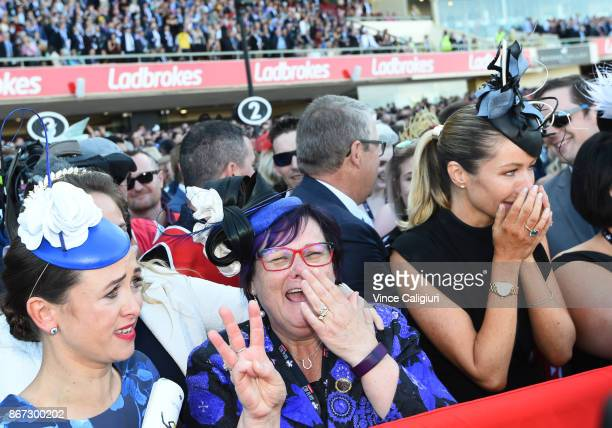 Christine Bowman Debbie Kepitis and Stephanie Waller react after Hugh Bowman wins aboard Winx in Race 9 Ladbrokes Cox Plate during Cox Plate Day at...