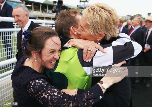 Christine Bowman hugs husband Hugh Bowman and part owner Patty Tighe after winning The Chelmsford Stakes with Unforgotten during Chelmsford Stakes...