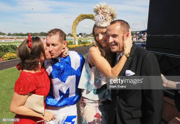 Christine Bowman kisses husband Hugh as Stephanie Waller hugs husband Chris after Winx won the George Ryder Stakesduring Golden Slipper Day at...