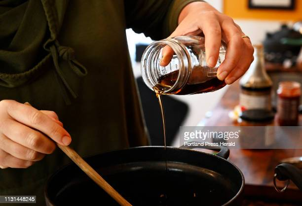 Christine Burns Rudalevige adds maple syrup to the sauce for Maple Miso Ramen/Green Plate Special Tuesday March 12 2019