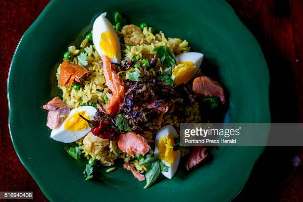 Christine Burns Rudalevige makes a kedgeree with smoked salmon basmati rice peas indian spices onions eggs shrimp cilantro and lime at her Brunswick...