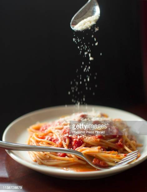 Christine Burns Rudalevige sprinkles cheese on a plate of pasta with Marcella Hazans tomato butter sauce flavored with kelp on Wednesday April 3 2019