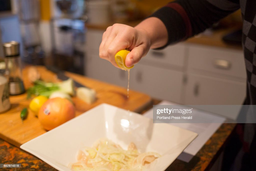 Christine Burns Rudalevige squeezes lemon on to the raw scallops for crudo with grapefruit, fennel and chili.
