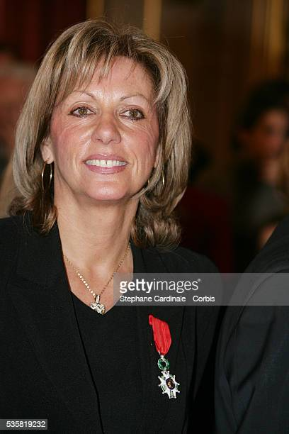 Christine Caron displays the Legion D'Honneur awarded by French President Jacques Chirac