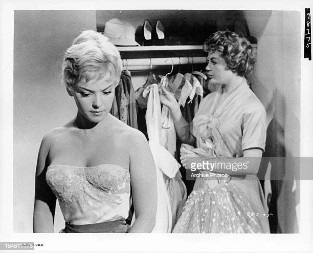 Christine Carère gets dressed as Sheree North looks for a dress in a scene from the film 'Mardi Gras' 1958