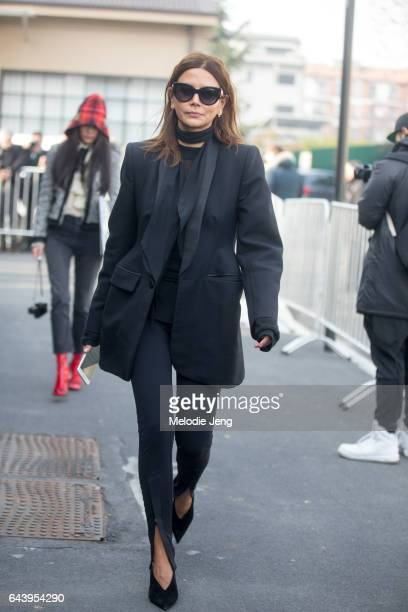 Christine Centenera in all black outside the Gucci show during Milan Fashion Week Fall/Winter 2017/18 on February 22 2017 in Milan Italy