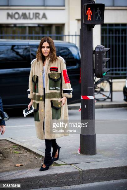 Christine Centenera is seen in the streets of Paris before the Miu Miu show during Paris Fashion Week Womenswear Fall/Winter 2018/2019 on March 6...