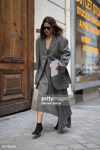 Christine Centenera is seen on the street attending Sacai during Paris Women's Fashion Week A/W 2018 wearing a grey blazer and grey pleated skirt on...