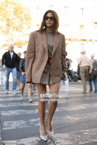Christine Centenera is seen on the street during Paris Fashion Week SS19 wearing Louis Vuitton belt with taupe dress and beige blazer on September 27...