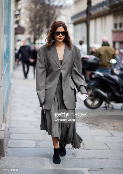 Christine Centenera is seen outside Sacai during Paris Fashion Week Womenswear Fall/Winter 2018/2019 on March 5 2018 in Paris France