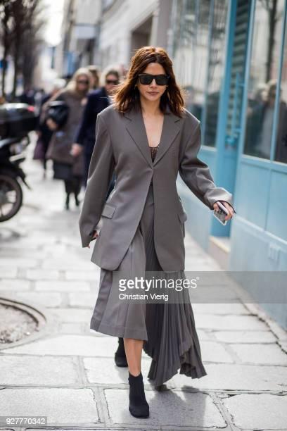 Christine Centenera is seen outside Sacai during Paris Fashion Week Womenswear Fall/Winter 2018/2019 on March 5 2018 in Paris France