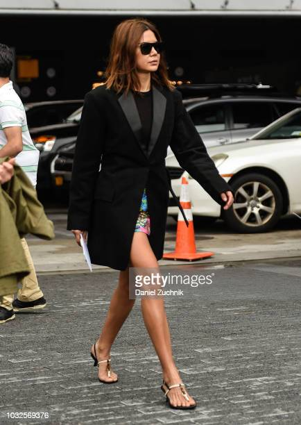 Christine Centenera is seen wearing a black tux jacket outside the Michael Kors show during New York Fashion Week Women's S/S 2019 on September 12...