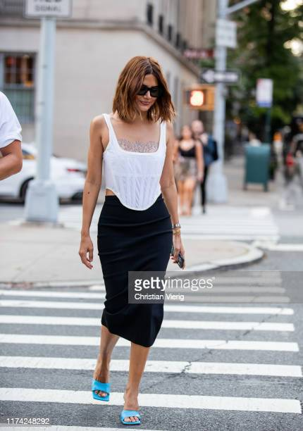 Christine Centenera is seen wearing black pencil skirt, white top outside Marc Jacobs during New York Fashion Week September 2019 on September 11,...
