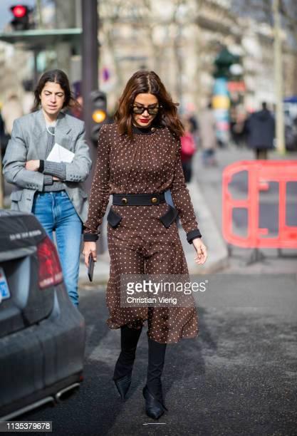 Christine Centenera is seen wearing brown dress outside Miu Miu during Paris Fashion Week Womenswear Fall/Winter 2019/2020 on March 05 2019 in Paris...