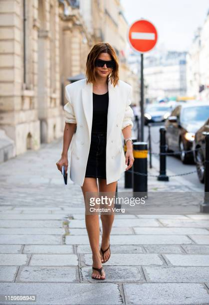 Christine Centenera is seen wearing white blazer outside Ralph Russo during Paris Fashion Week Haute Couture Fall/Winter 2019/2020 on July 01 2019 in...