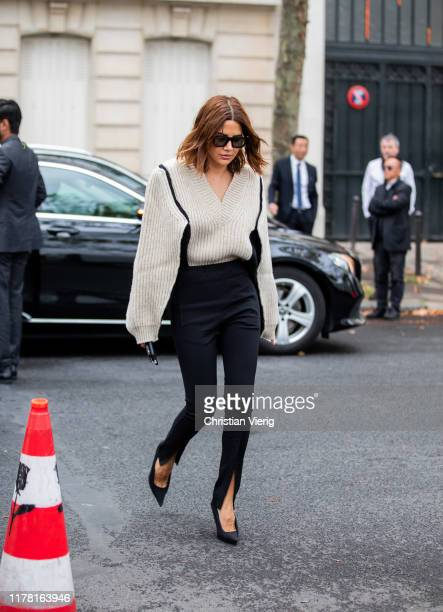Christine Centenera seen wearing creme white v neck knit with strong sleeves outside Valentino during Paris Fashion Week Womenswear Spring Summer...