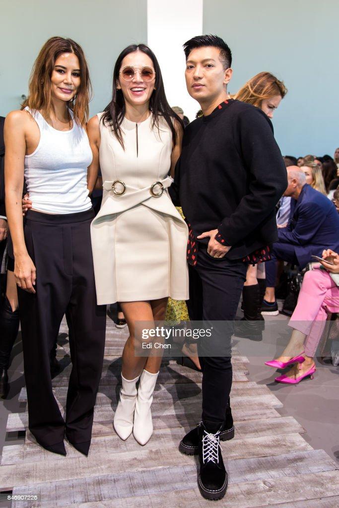Christine Centenera, Tina Leung & Bryan Grey Yambao attend the Michael Kors runway show during New York Fashion Week at Spring Studios on September 13, 2017 in New York City.