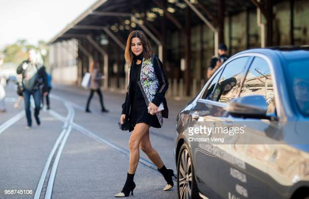 Christine Centenera wearing black dress with long sleeves vest with floral print during MercedesBenz Fashion Week Resort 19 Collections at...