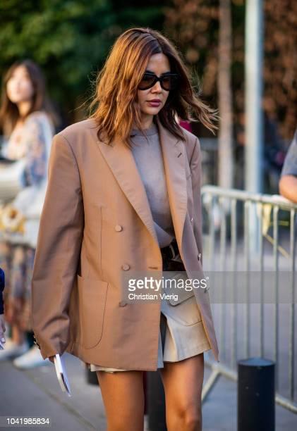 Christine Centenera wearing brown blazer is seen outside Chloe during Paris Fashion Week Womenswear Spring/Summer 2019 on September 27 2018 in Paris...