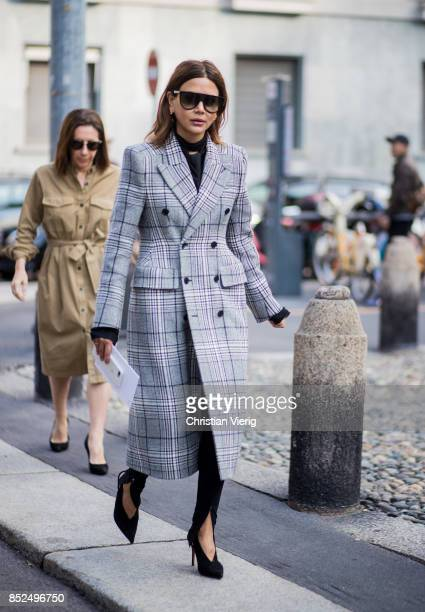 Christine Centenera wearing checked coat is seen outside Bottega Veneta during Milan Fashion Week Spring/Summer 2018 on September 23 2017 in Milan...