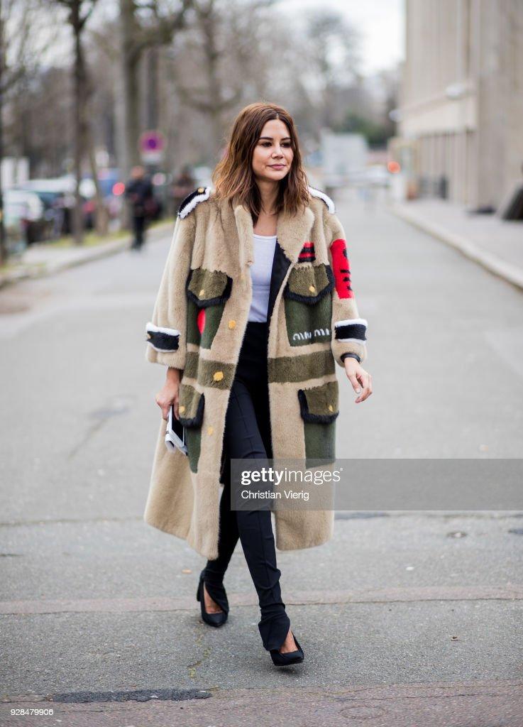 Christine Centenera wearing Miu Miu coat seen outside Miu Miu during Paris Fashion Week Womenswear Fall/Winter 2018/2019 on March 6, 2018 in Paris, France.