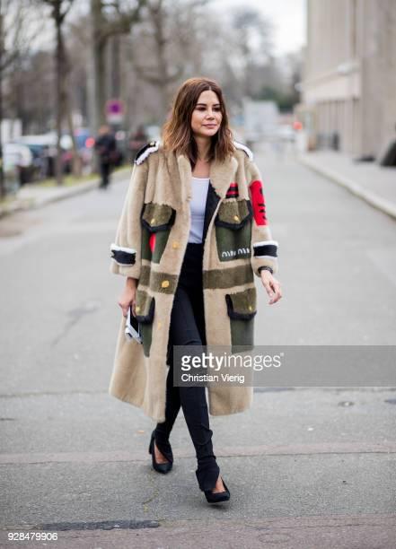Christine Centenera wearing Miu Miu coat seen outside Miu Miu during Paris Fashion Week Womenswear Fall/Winter 2018/2019 on March 6 2018 in Paris...