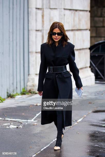 Christine Centenera wearing Off White sunglasses and black coat is seen in the streets of Paris before the Chloe show during Paris Fashion Week...