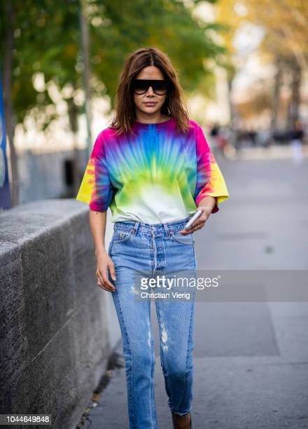 Christine Centenera wearing rainbow tshirt denim jeans is seen outside Sacai during Paris Fashion Week Womenswear Spring/Summer 2019 on October 1...