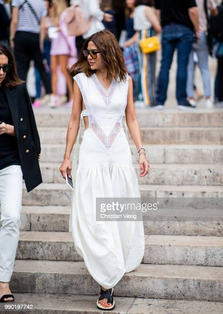 Christine Centenera wearing white dress is seen outside Schiaparelli on day two during Paris Fashion Week Haute Couture FW18 on July 2 2018 in Paris...