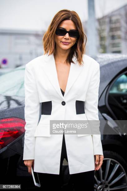 Christine Centenera wearing white jacket and black pants is seen in the streets of Paris after the Balenciaga show during Paris Fashion Week...