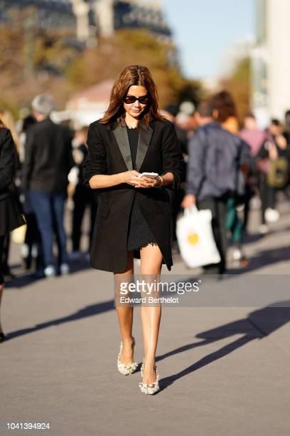 Christine Centenera wears a black blazer jacket outside Rochas during Paris Fashion Week Womenswear Spring/Summer 2019 on September 26 2018 in Paris...