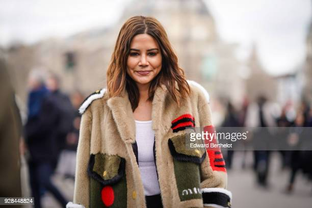 Christine Centenera wears a Miu Miu fluffy coat outside Miu Miu during Paris Fashion Week Womenswear Fall/Winter 2018/2019 on March 6 2018 in Paris...