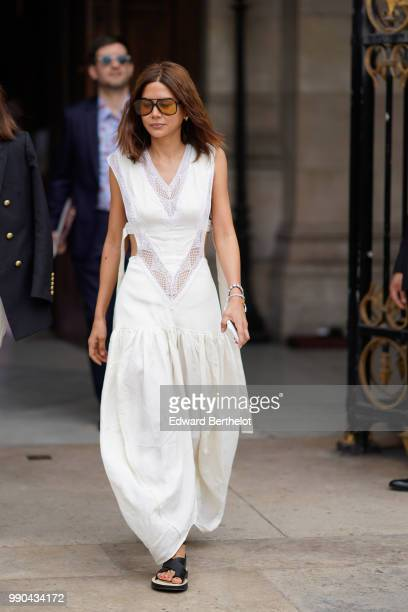 Christine Centenera wears a white outfit outside Schiaparelli during Paris Fashion Week Haute Couture Fall Winter 2018/2019 on July 2 2018 in Paris...