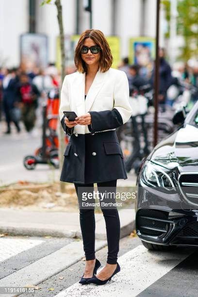 Christine Centenera wears sunglasses a black and white blazer jacket black pants pointy shoes outside Paco Rabanne during Paris Fashion Week...
