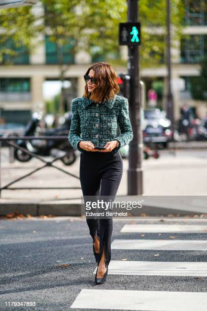 Christine Centenera wears sunglasses a green tweed jacket with buttons and shoulder pads black pants shoes outside Miu Miu during Paris Fashion Week...