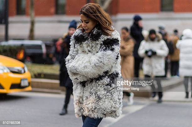 Christine Centenera weraing a white black white fur jacket and a grey shirt seen outside Tommy Hilfiger during New York Fashion Week Women's...