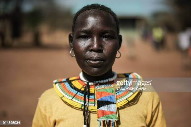Christine Chepetemo who has six children poses during a meeting with journalist on the topic of female genital mutilation at Katabok village...