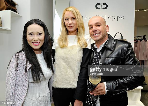 Christine Chiu designer Dee Ocleppo and Nicola Guarna attend Dee Ocleppo PA at Saks Fifth Avenue Beverly Hills on October 17 2014 in Beverly Hills...