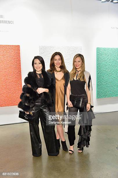 Christine Chiu Mae Brunken and Mayleen Ramey attend the LA Art Show 2017 opening night premiere hosted by Emma Roberts benefiting St Jude Children's...