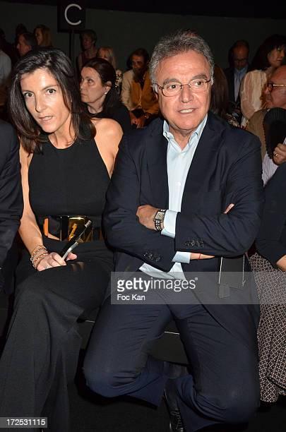 Christine Couland and Alain Afflelou attend the Stephane Rolland Front Row Paris Fashion Week HauteCouture F/W 20132014 at the Tennis Club de Paris...