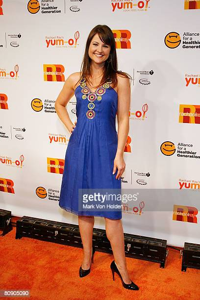 Christine Cunningham poses for a photo Rachael Ray with special guest President Clinton open PopUp restaurant Cafe Una Notte to benefit Yumo...
