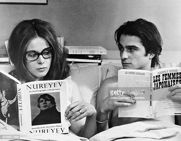 Christine Doinel and husband Antoine Doinel reading in bed in the 1970 French film Domicile Conjugal, titled Bed and Board when released in the...